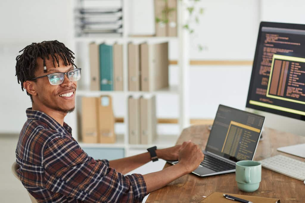 IT specialist smiling at work
